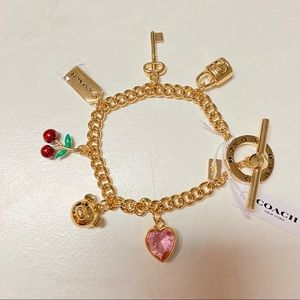 New Coach gold charm bracelet heart cherry bear